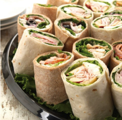 Tray of delicious sandwich wrap from Sugar and Spice Cafe